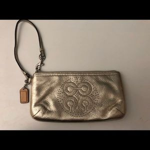 Gold Coach leather wristlet